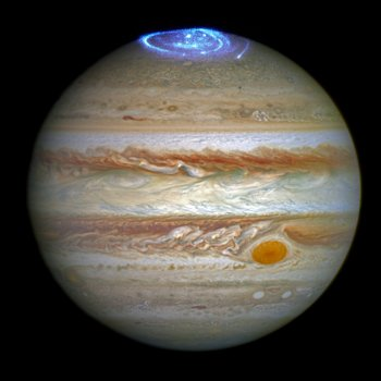 A spectacular image of auroras in Jupiter's northern hemisphere, taken by the Hubble Space Telescope in the spring of 2014. Photo Credit: NASA/ESA