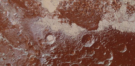 Enhanced color image of Pluto's surface, showing ice fields, mountains and craters. Image Credit: NASA/JHUAPL/SwRI