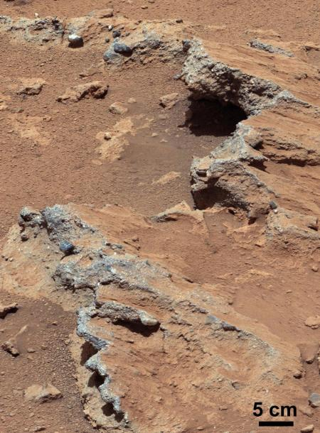 One of the conglomerate rock outcrops, called Hottah, which contains embedded streambed gravel. Other gravel lies loose on the ground nearby. Credit: NASA / JPL-Caltech / MSSS