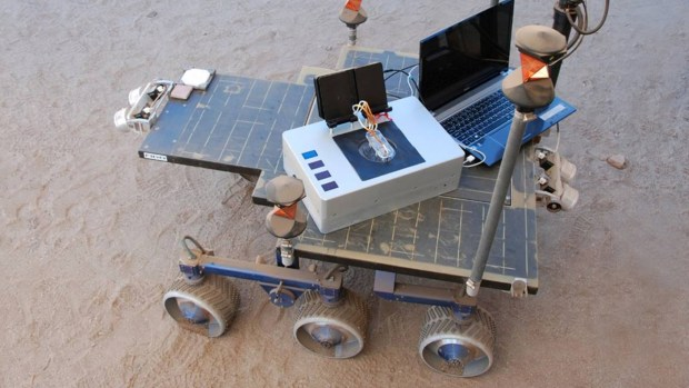 The Chemical Laptop attached to a test rover in the Mars Yard at JPL. Photo Credit: NASA/JPL-Caltech