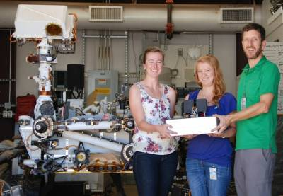 JPL researchers Jessica Creamer, Fernanda Mora and Peter Willis (left to right) pose with the Chemical Laptop. Photo Credit: NASA/JPL-Caltech