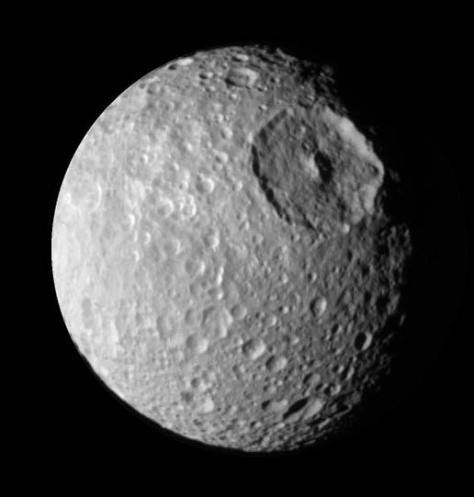 Mimas, seen by Cassini. We can the crater Herschel, which makes Mimas look like Star Wars' Death Star. Credit: NASA