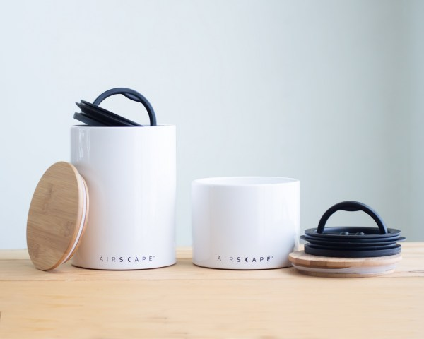 Photo of a large and small white airscape coffee canister set.