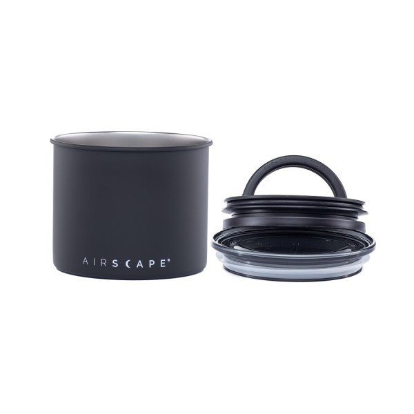 Photo of small, matte black, stainless steel Airscape kitchen cannister with lid and seal to the right