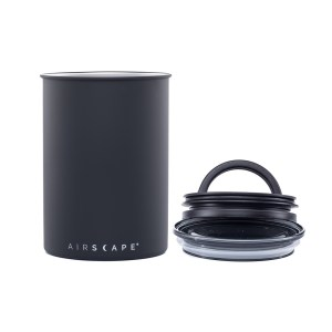 Photo of medium, matte black, stainless steel Airscape kitchen cannister with lid and seal to the right