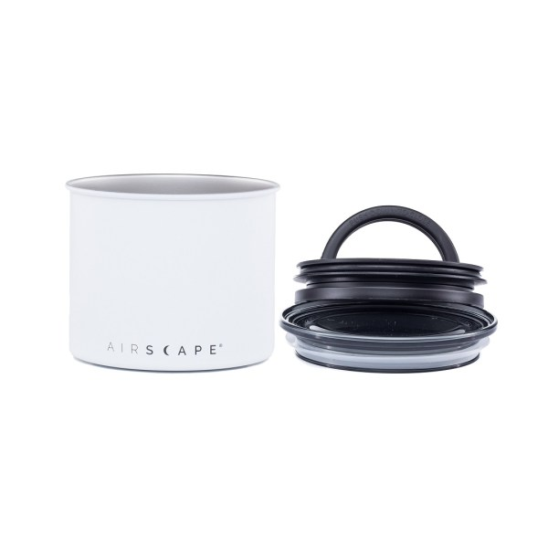 Photo of small, matte white, stainless steel Airscape kitchen cannister with lid and seal to the right