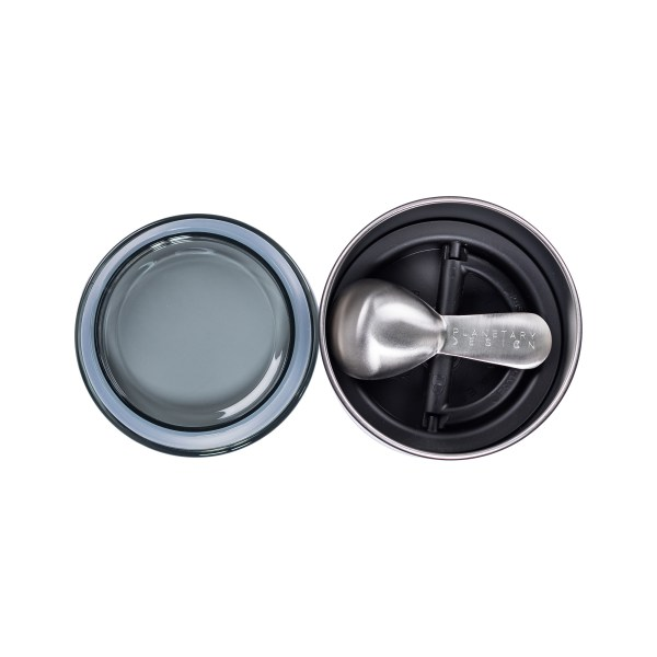 Photo of stainless steel coffee scoop inside of an Airscape storage canister