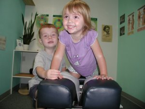 kids on a chiropractic adjusting table