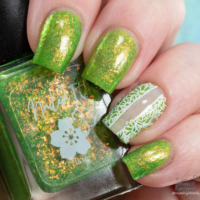 Pictured is a swatch of four fingers painted with nail art on ring finger by Britta in the nail polish Lush apart of the four piece Secret Garden Collection by Nailed It! Nail Polish.