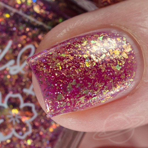 4 finger swatch of Nailed It Nail Polish Love Bug one of four polishes in the Candygram Collection Macro