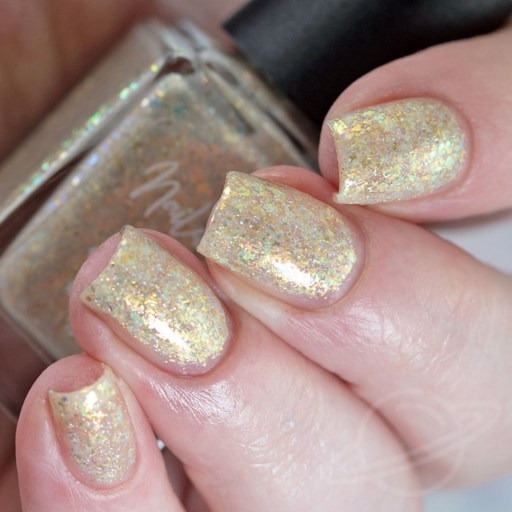 4 finger swatch of Nailed It Nail Polish X's & O's one of four polishes in the Candygram Collection