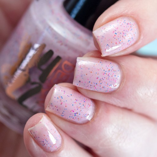 Picture of nail polish swatch (4 fingers) by 1422 Designs Have Your PEEPS Cake and Eat It Too - a bubble gum pink polish with purple-pink-orange shifting shimmer and matte glitters of purple, blue, pink, green, and yellow