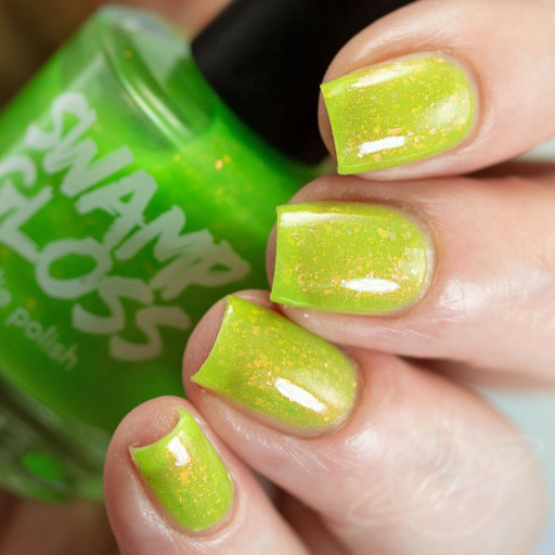 Picture of nail polish 4 finger swatch created by Swamp Gloss Polish Watermelon Sugar - A neon green jelly with red/peach/orange shimmer and matching iridescent flakies with a UV charges green glow