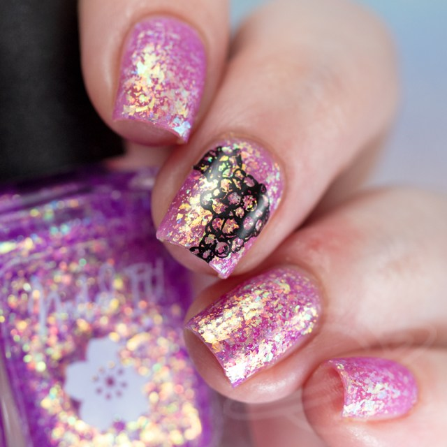 This image features a four finger swatch with the nail polish Eternally Grapeful: A Purple jelly base packed with gold/copper/green crystal flakes, and a touch of holo flakies from Nailed It! Nail Polish new collection Taste the Rainbow