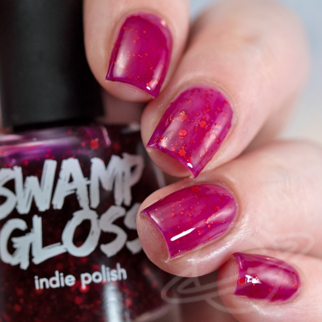 Pictured here is a nail polish by Swamp Gloss Polish. This magenta polish with glitter is named What's Up B*tches and is inspired by Supernatural. A part of The Very Supernatural Collab