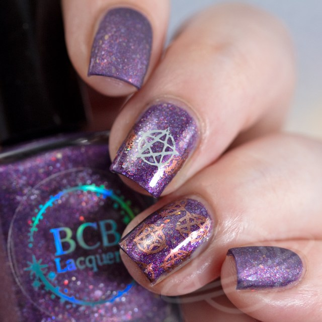 4 finger nail swatch of nail polish named Non Timebo Mala by BCB Lacquers with Supernatural inspired nail art -polish is purple with flakies. Part of The Very Supernatural Collab