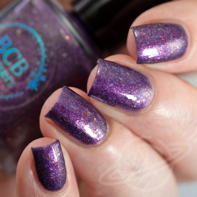 4 finger nail swatch of nail polish named Non Timebo Mala by BCB Lacquers - polish is purple with flakies. Part of The Very Supernatural Collab