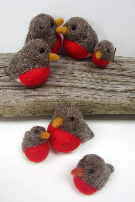 a group of needlefelt robins