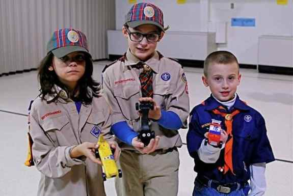 Showing Off Their Imaginations (l-r) - Derby design winners Elijah Rand (1st for banana car), Dante Orlando (2nd for car modeled after Chess game King piece), Matthew Tolin (3rd place for R2D2 driven futuristic race car).