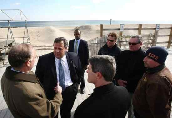 Gov. Chris Christie, DEP Commissioner Bob Martin and Mayor Ken Farrell toured the boardwalk to view the dunes that protected Sea Girt from major damage during Hurricane Sandy. Photo: Tim Larsen, the Governor's Office.