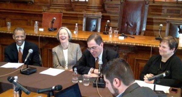 Presidential search committee vice chair Brent Henry (l), Shirley Tilghman, Chris Eisgruber, and search committee chair Kathryn Hall (r) share a laugh at the press conference.