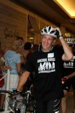 An exhausted but elated Steve Schultz of Princeton crosses the finish line of the Ride for Runaways Saturday.