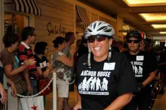 Sue Glass of Lawrence is all smiles as the Anchor House cyclists celebrate at the Quaker Bridge Mall Saturday.