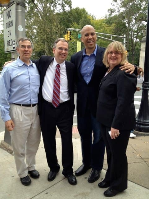 Princeton Council members Patrick Simon and Jenny Crumiller get their photo taken with Rush Holt and Cory Booker.