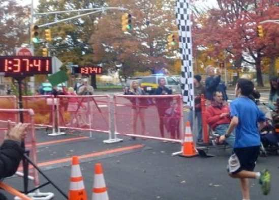 Alex Ackerman of Princeton reaches the finish. He was one of two 13 year olds in the race. Photo courtesy of Andi Ackerman.