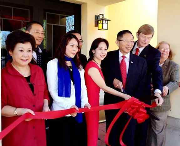 Lisa Shao, Peony Pavilion owner (center in red) and West Windsor Mayor Shing-Fu Hsueh celebrate the restaurant's opening with other dignitaries at a ribbon cutting ceremony Monday.