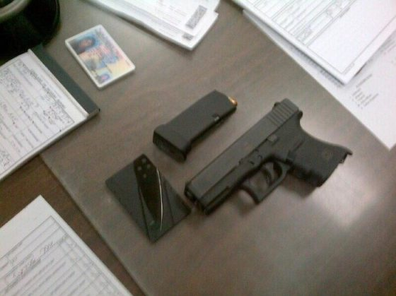 The gun and knife allegedly confiscated by police at the Philadelphia International Airport.