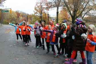 Members of Girls on the Run volunteering at a water stop for the 2013 Princeton Half Marathon.