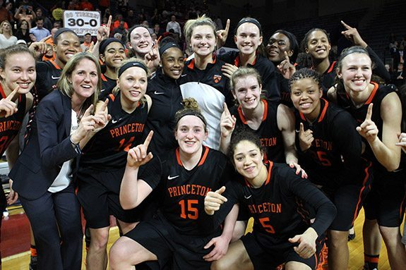 Head Coach Courtney Banghart and members of the Princeton University women's basketball team celebrate their 30-0 regular season record last week in Philadelphia after defeating the University of Pennsylvania. Photo by Beverly Schaefer courtesy of Princeton University Athletic Communications.
