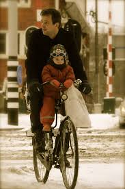 gent and child on bike