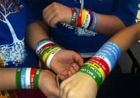 Students wear colorful wristbands to promote the Roots program. Photo courtesy of Elizabeth Levy Paluck, Princeton University.