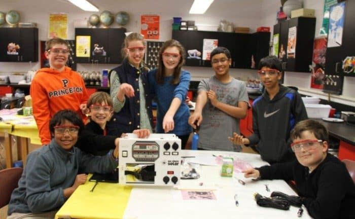 Princeton Day School Middle School students showcasing their finished solar suitcase.