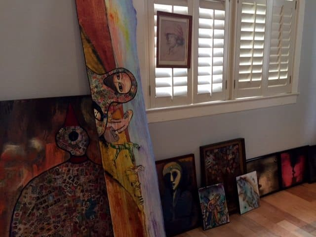 Some paintings by Princeton artist Chris Harford that are ready to be hung on walls at the Art Attack Pop-up Gallery at the corner of Spring and Tulane streets.