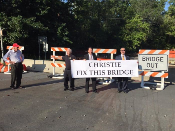 Officials from Franklin Township send a message to Gov. Chris Christie on Friday at the bridge on Route 518. Photo: Carla Zimowsk.