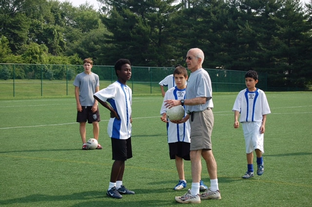Princeton resident John Heilner chats with students on the soccer field.