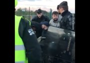 Well Damn: French Police Officer Drags A Protestor Out Of His Wheelchair Over Fears That He Is Armed!