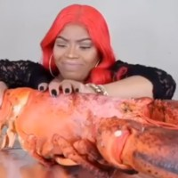 Woah: Woman Eats A Massive 15 Pound Lobster!