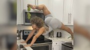 She's Sexy: Chick Eats Grapes While Doing Yoga In The Kitchen!