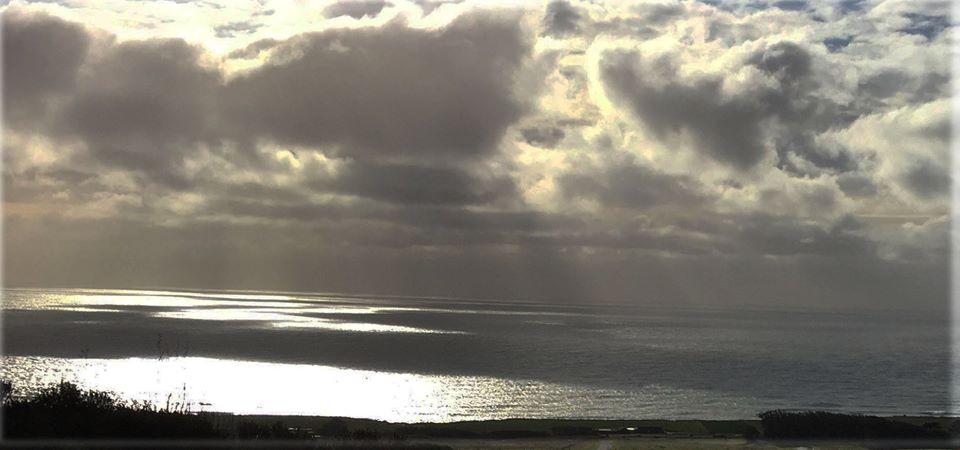 Slanty rays of sun over ocean