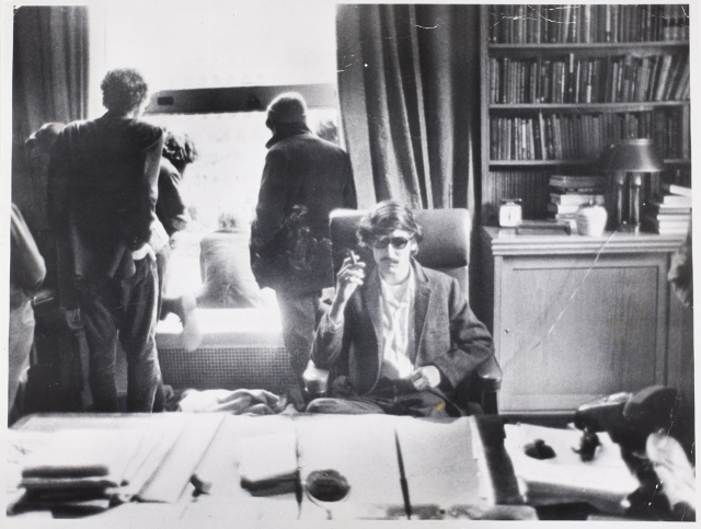 Gerald S. Upsham, Student activist David Shapiro sitting behind University President Kirk's desk smoking an appropriated cigar during six-day campus uprising and protest at Columbia University, New York], May 1968 Upsham's image illustrates the attitude perfectly. David Shapiro, in an act of protest over Columbia's involvement in the Vietnam War, stormed President Grayson L. Kirk's office—for what purpose, beyond the obvious photo op—it is difficult to say. In this photograph he appears disinterested; detached from the giddy cluster of fellow SDS member crowding the window in the background. He is at ease, reaping the rewards of his impromptu coup d'état. I suppose the city's romance with cigarettes had to come to an end, but revisiting these images gave me a sense of nostalgia for a decidedly younger and grittier city.