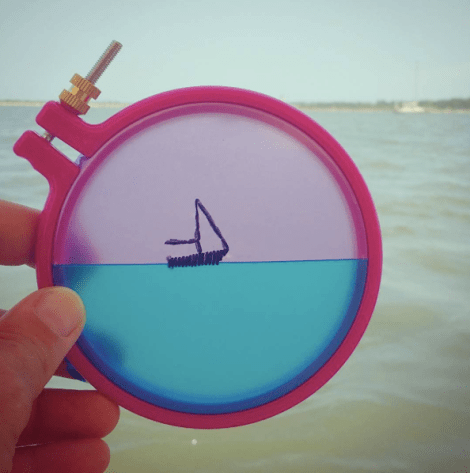 This is a sailboat embroidered onto a found beach ball.