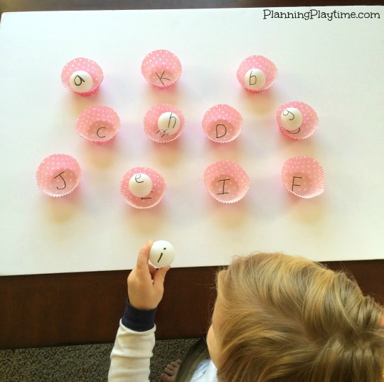 Preschool Letter Recognition Activities Matching Upper and Lowercase Letters with Ping Pong Balls and Cupcake liners.