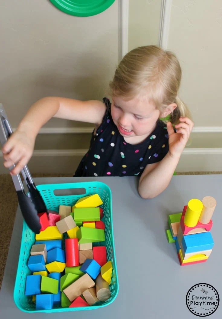 Tower Building with Tongs - Fine Motor Toddler Activities #toddler #toddleractivities #ideasfortoddlers #planningplaytime #ad
