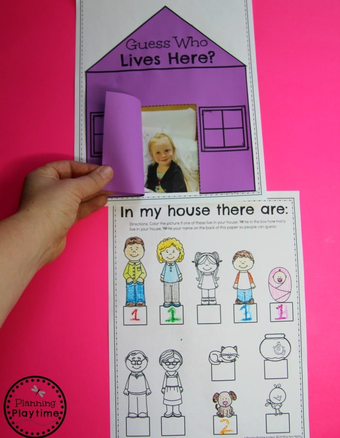 child pulling back door of paper house to show picture underneath. drawing with family members and numbers of how many below.
