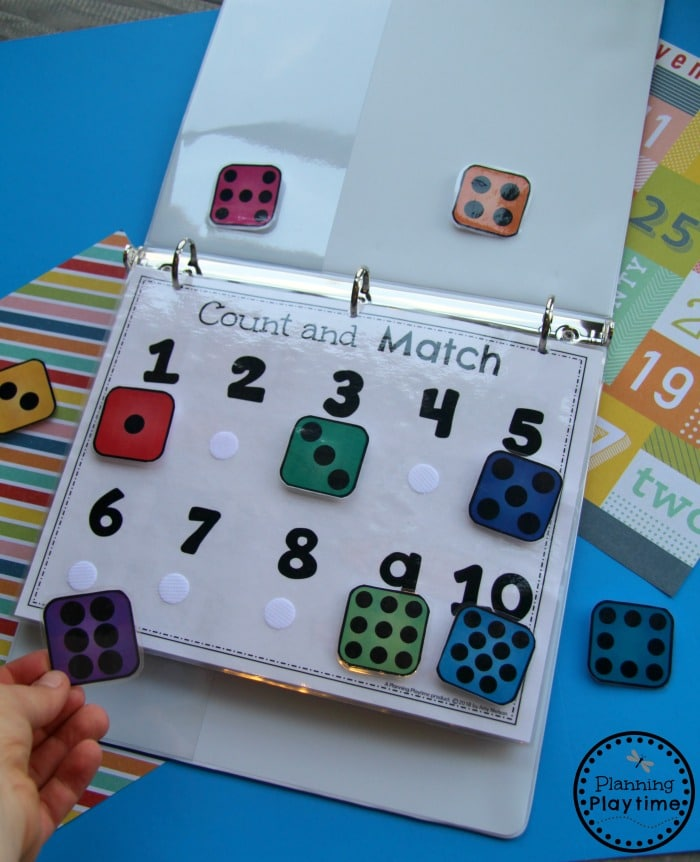 binder with preschool pages. Numbers with velcro dots and matching dice to match and attach