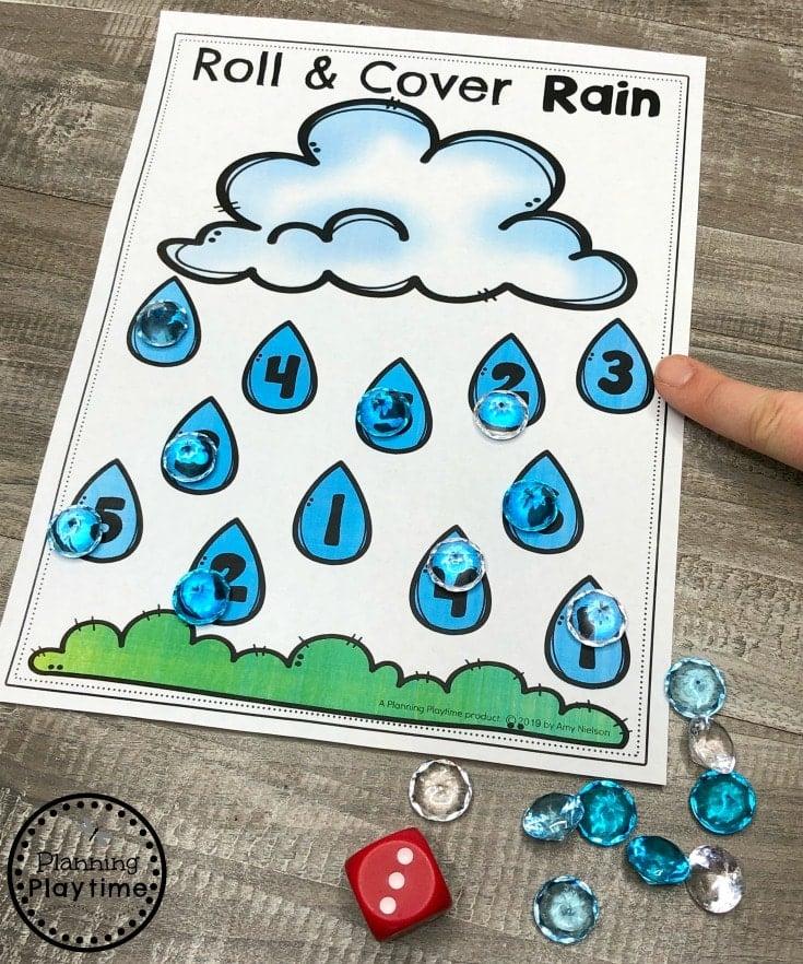 Preschool Weather Activities - Roll and Cover Rain Math Game #planningplaytime #weathertheme #preschoolactivities #preschoolworksheets #springworksheets #planningplaytime #weathertheme #preschoolactivities #preschoolworksheets #springworksheets